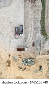 Trucks on a consruction site seen from above, photo taken by drone