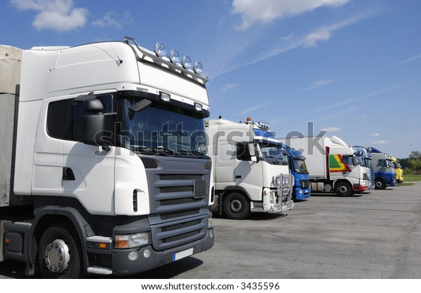 trucks on line waiting for cargo, all trademarks removed