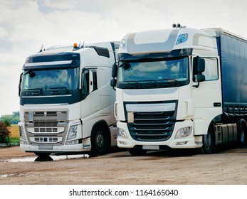 Trucks on the road in Poland. Lorry transport delivering some freight cargo.