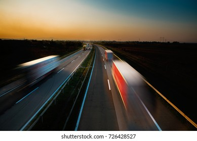 Trucks on the road in the sunset