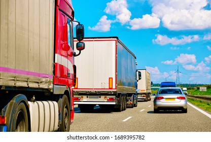 Trucks in the road of Poland. Lorry transport delivering some freight cargo.
