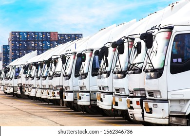 Trucks in a row with Container background. Business of logistic and transport concept.
