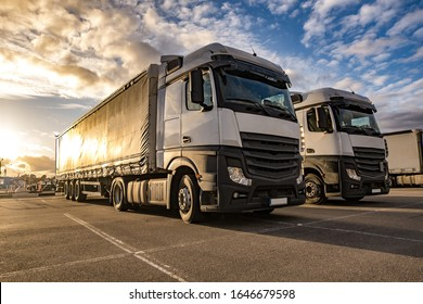 Trucks in a row with containers in the parking lot. Logistic and Transport concept