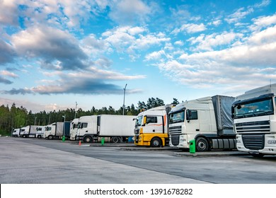 Trucks in a row with containers in the parking lot near forest , Logistic and Transport concept