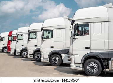 Trucks stand in line side view