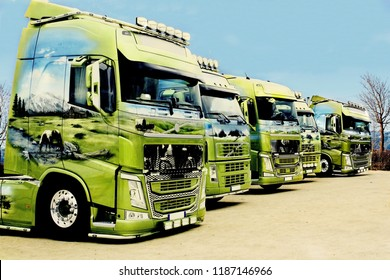 Trucks standing in a row in a parking lot in nature