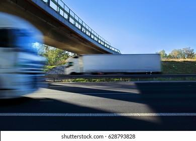 Trucks transportation under bridge