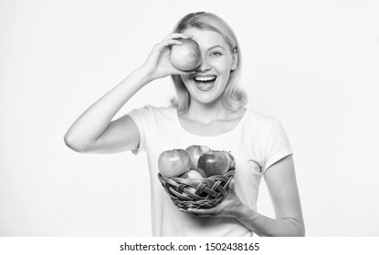 True happiness. orchard, gardener girl with apple basket. autumn harvest. Spring seasonal fruit. farming concept. healthy teeth. vitamin diet and food shooping. Happy woman eating apple. Pick fruits.
