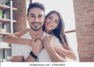 True love. Beautiful latino couple of young lovers are hugging indoors at home, with love and tenderness, wearing casual clothes