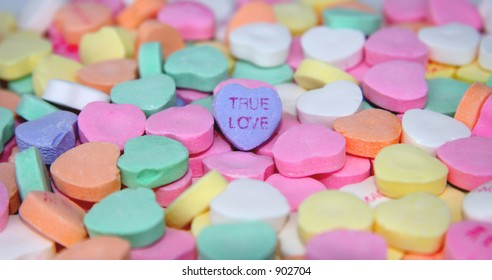 """True Love"" candy heart surrounded by other candy hearts."