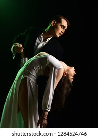 True love at its finest. Couple of mime artists perform romance on stage. Mime man and woman act in romantic scene. Couple in love with mime makeup. Theatre actors miming through body motions.