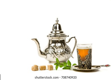 True Moroccan mint tea in the original cup and teapot on the white background