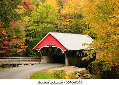 A True New England Scene: a Covered Bridge Surrounded by Fall Foliage in the Franconia Notch State Park, New Hampshire