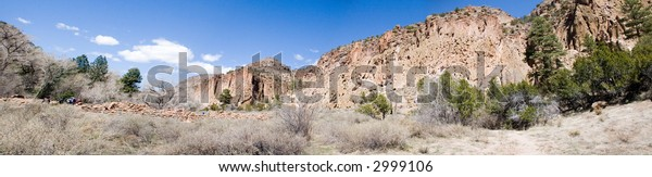 True wide panorama of the ancient American Indian ruins at Bandalier National Monument in central New Mexico in the early spring.