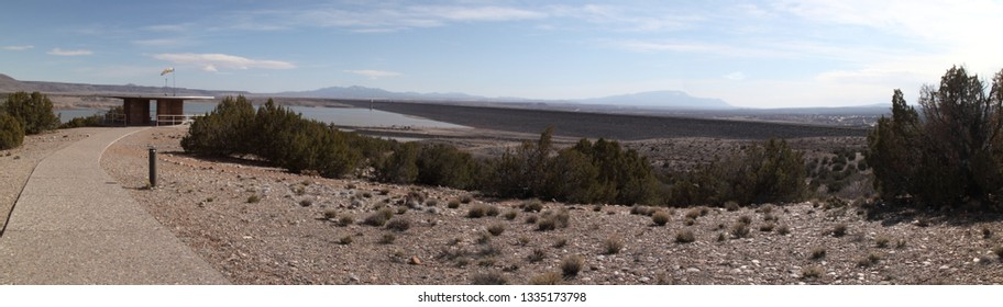 True wide panorama of Cochiti Lake, including the dam and the scenic overlook, in central New Mexico, just north of Albuquerque