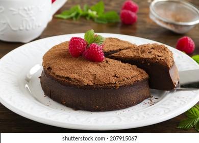 Truffle chocolate cake with raspberries.
