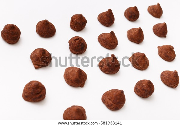 Truffles pattern, top view flat lay of various chocolate pralines candy on white background. Chocolate Candy, Truffle.