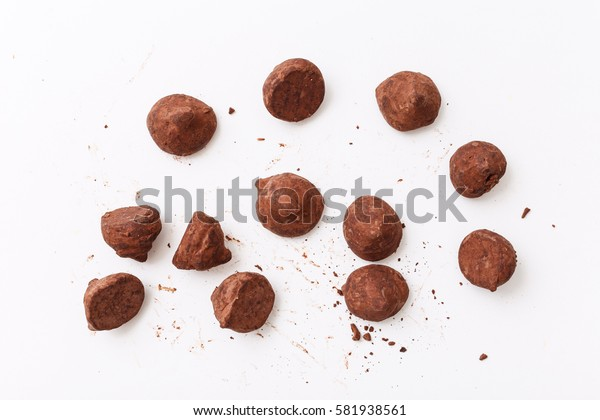 Truffles pattern, top view flat lay of various chocolate sweets. Minimal concept above decoration on white food background. Chocolate Candy, Truffle.