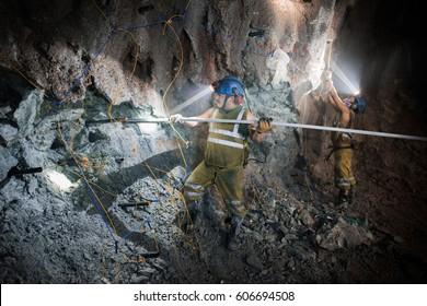 TRUJILLO, PERU - CIRCA 2015: Two men  work with explosives in a mine circa 2015 in Trujillo, Peru.