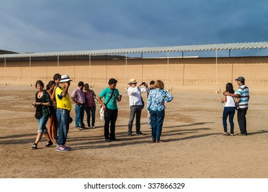 TRUJILLO, PERU - JUNE 6, 2015: Tourists visit the ruins of adobe city Chan Chan in Trujillo, Peru