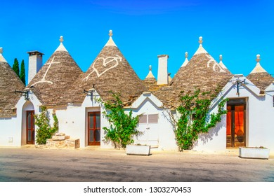 Trulli of Alberobello typical houses street view. Apulia, Italy. Europe.
