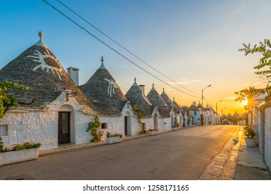 Trulli houses in Alberobello city at sunset time,  Apulia, Italy