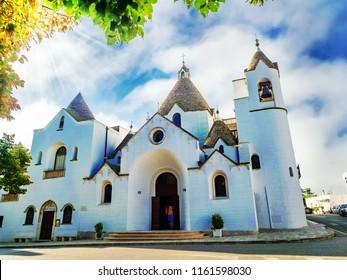 A Trullo-church landscape, Saint Antonio church of Trulli village in Alberobello, Apulia region of Italy.