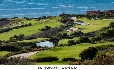 The Trump National Golf Course, in Rancho Palos Verdes along the Pacific coast of California, opened in 2006. Fairway and greens with lakes, sand traps and an American flag are seen, ocean background.