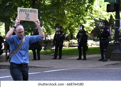 Trump Protester | June 4th 2017 | Portland OR| A peaceful protester silently walks the line of riot police holding his message high.