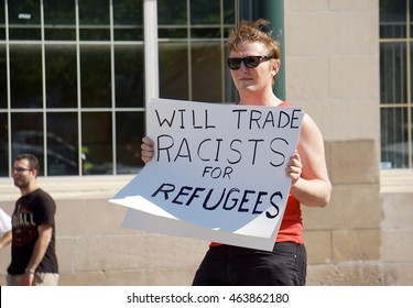 Trump Rally Portland, Maine USA 08/04/2016, Clinton Supporter Holding Sign Which Reads Will Trade Racist For Refugees, Campaigning Against Donald Trump