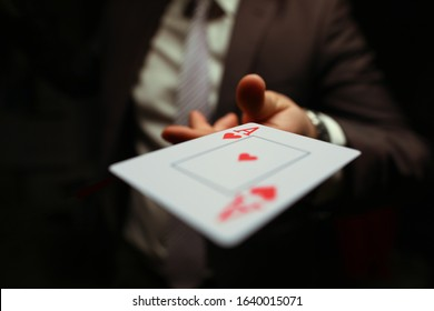 Trump in the sleeve, strategy business card game. Gambling cards, man suit throws card to floor. Man in suit throws card. Gambling creates annoyance and frustration. Player throws game.