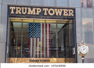 Trump Tower on 5th Avenue in Manhattan, New York. Golden tone metal letters. American flag is hanging. One of many Trump build buildings, and one of the busiest  places in NY. August 9 2019