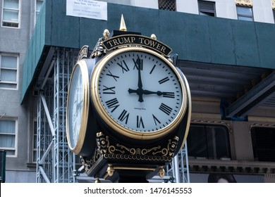 Trump Tower on 5th Avenue in Manhattan, New York. Gold and black stylish clock with white dial are showing 3 pm. One of many Trump build buildings, and one of the busiest  places in NY. August 9 2019