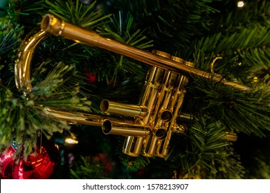 A trumpet hanging in a Christmas tree for the holidays