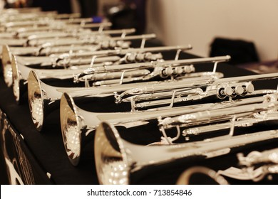 Trumpet models placed on the table, Music instruments.