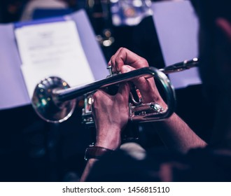 Trumpet player closeup concert music background