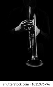 Trumpet player hands playing jazz music instrument close up. Brass orchestra instruments