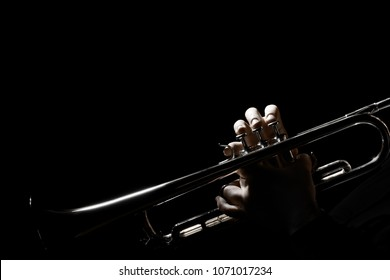 Trumpet player. Hands of trumpeter playing jazz brass instrument isolated on black
