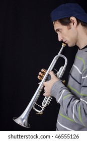 Trumpet player male on black isolated