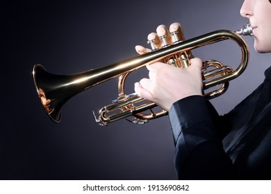 Trumpet player playing jazz music instrument. Brass jazz player trumpeter hands closeup