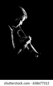 Trumpet player playing jazz music. Trumpeter musician jazz instrument.