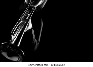 Trumpet player. Trumpeter playing jazz instrument. Orchestra brass musical instruments closeup