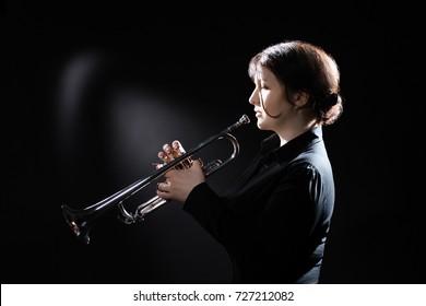 Trumpet player. Trumpeter playing jazz musical instrument.