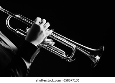 Trumpet player. Trumpeter playing music jazz instrument. Brass orchestra instrument.