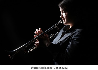Trumpet player. Woman trumpeter playing Jazz musician with brass instrument