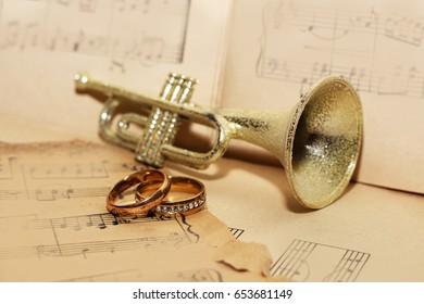 trumpet and wedding rings, old paper