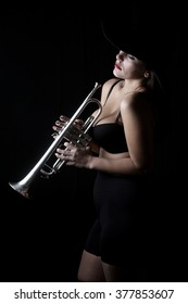 trumpet and a woman - musical instrument - beautiful young woman - shadows - valves and tubes