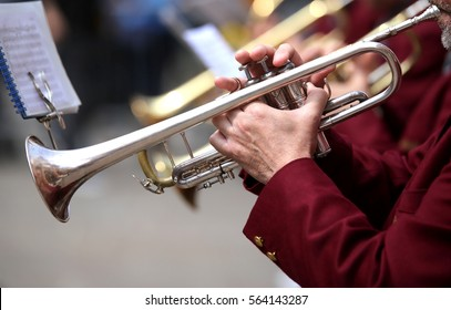 trumpeter plays his trumpet in the band during live concert