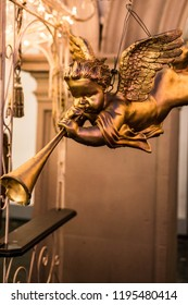A trumpeting golden music angel statue detail on a german christmas market