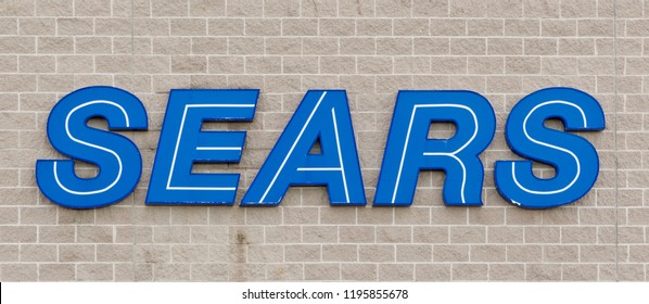 TRURO, CANADA - NOVEMBER 09, 2013: Sears store sign. Sears is an American department store retailer which was surpassed by Walmart as the United States biggest retailer in domestic revenue.